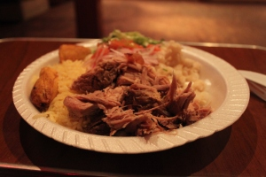 this is really a more typical lojano dish.  pulled pork, a MOUNTAIN of rice, fried maduros, and a tomato and onion salad.