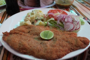 this is milanesa de pollo, with an unusually large portion of ensalada.  but generally speaking, if the meat takes up at least 70% of the plate you can expect satisfied customers.